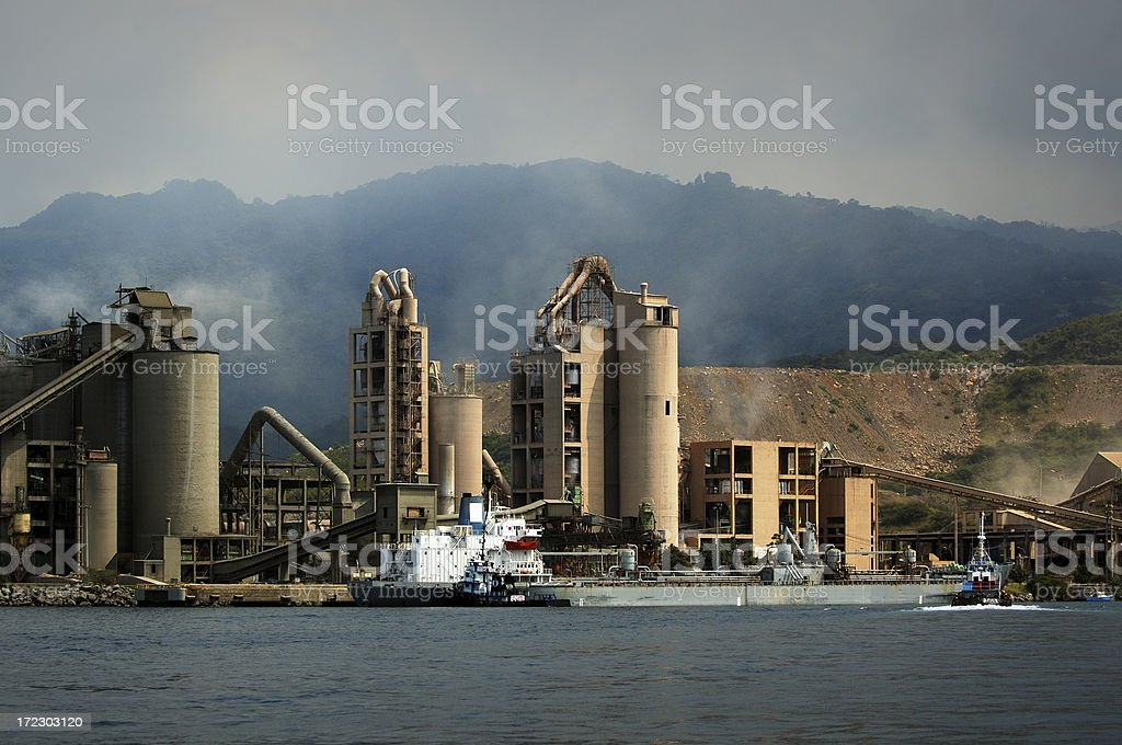 Cargo Ship Docked at Industrial Shipping Port Terminal royalty-free stock photo