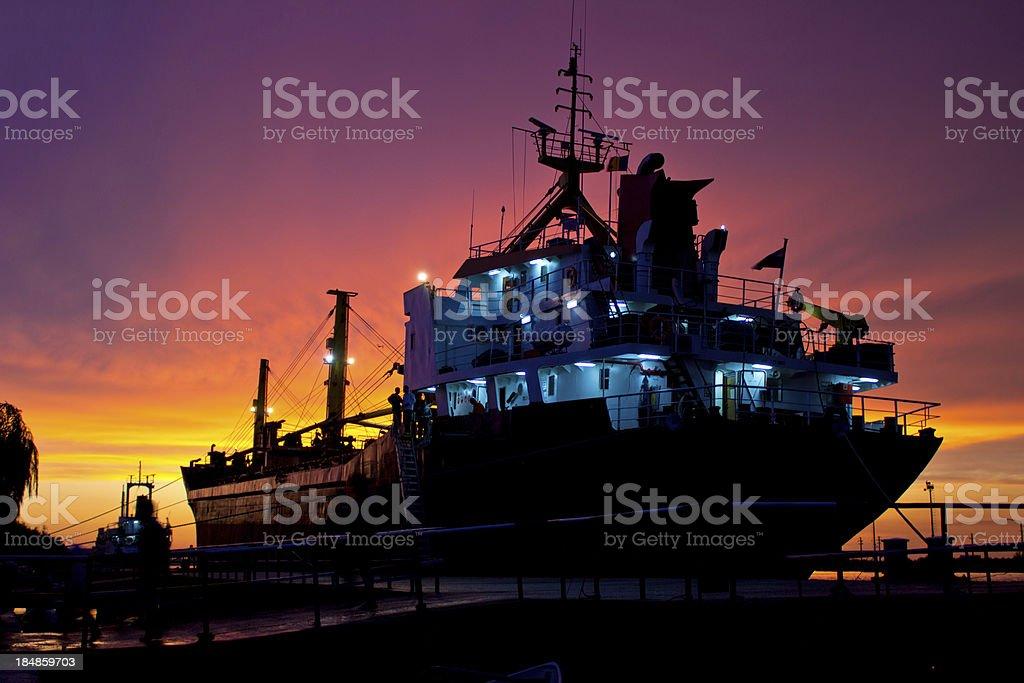 Cargo ship docked in harbor stock photo