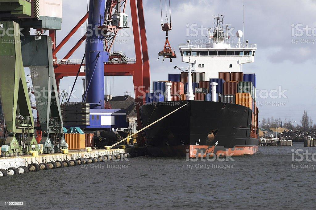Cargo ship docked royalty-free stock photo
