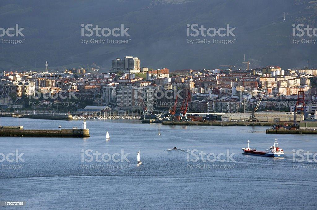 cargo ship entering at bilbao harbor royalty-free stock photo