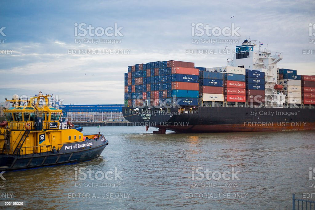 Cargo ship entering Port of Rotterdam stock photo