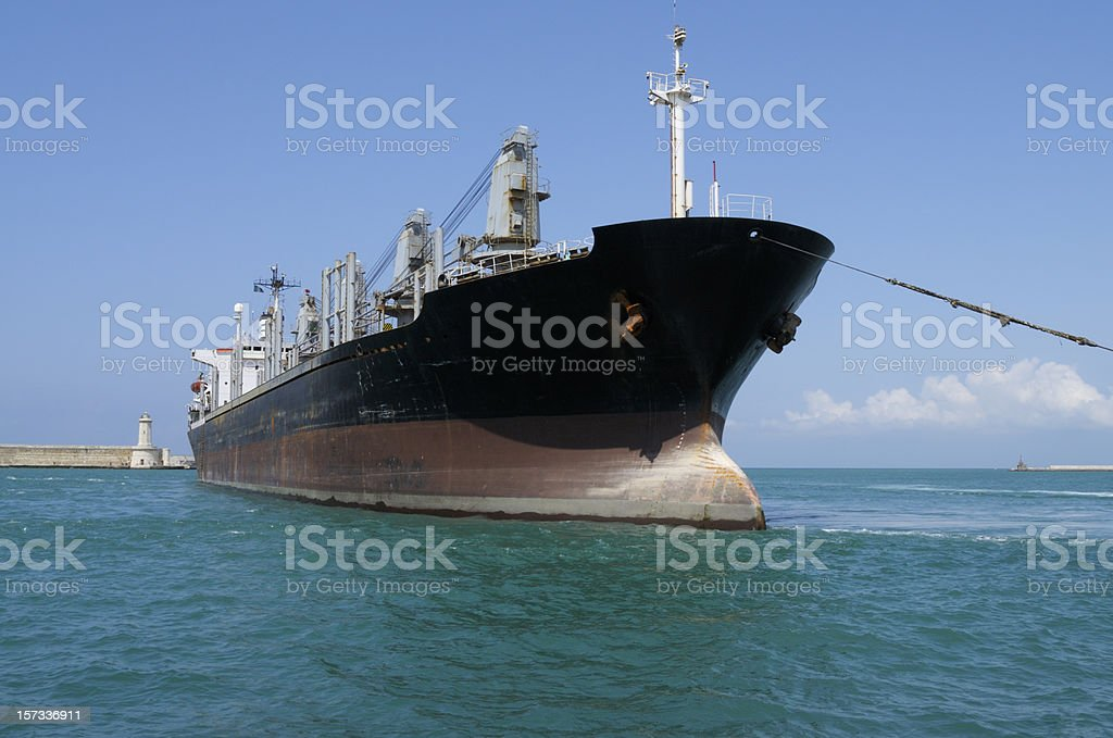 Cargo Ship Entering the Harbor royalty-free stock photo