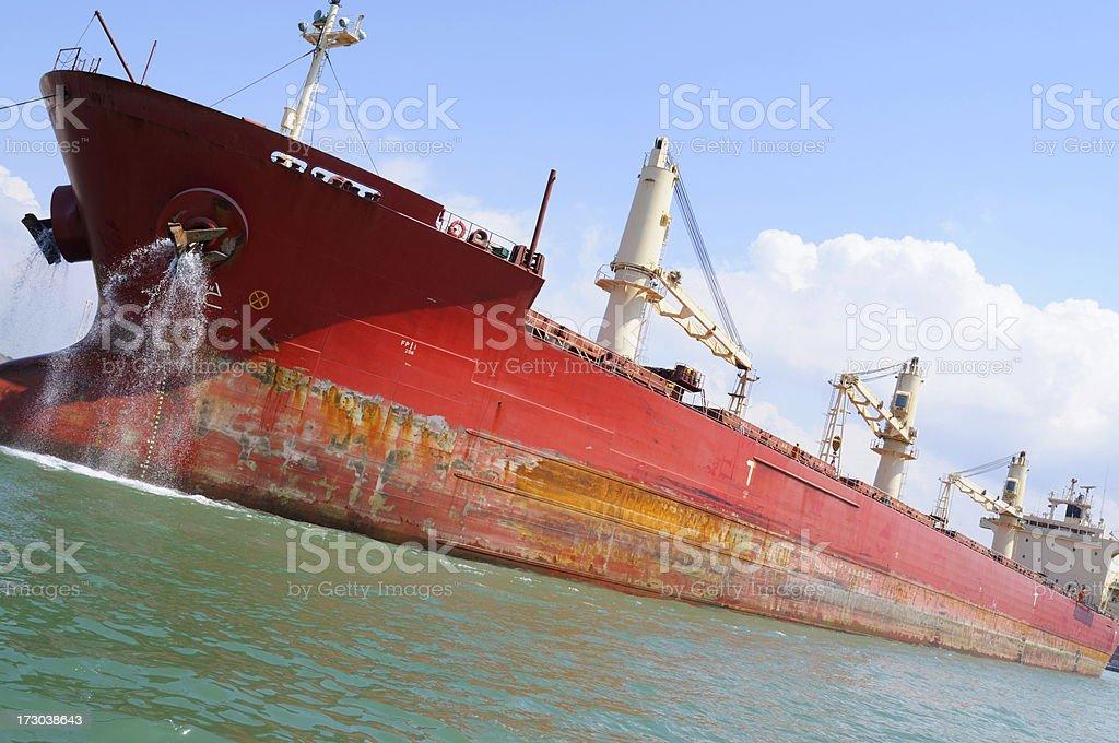 Cargo ship entering the harbor royalty-free stock photo