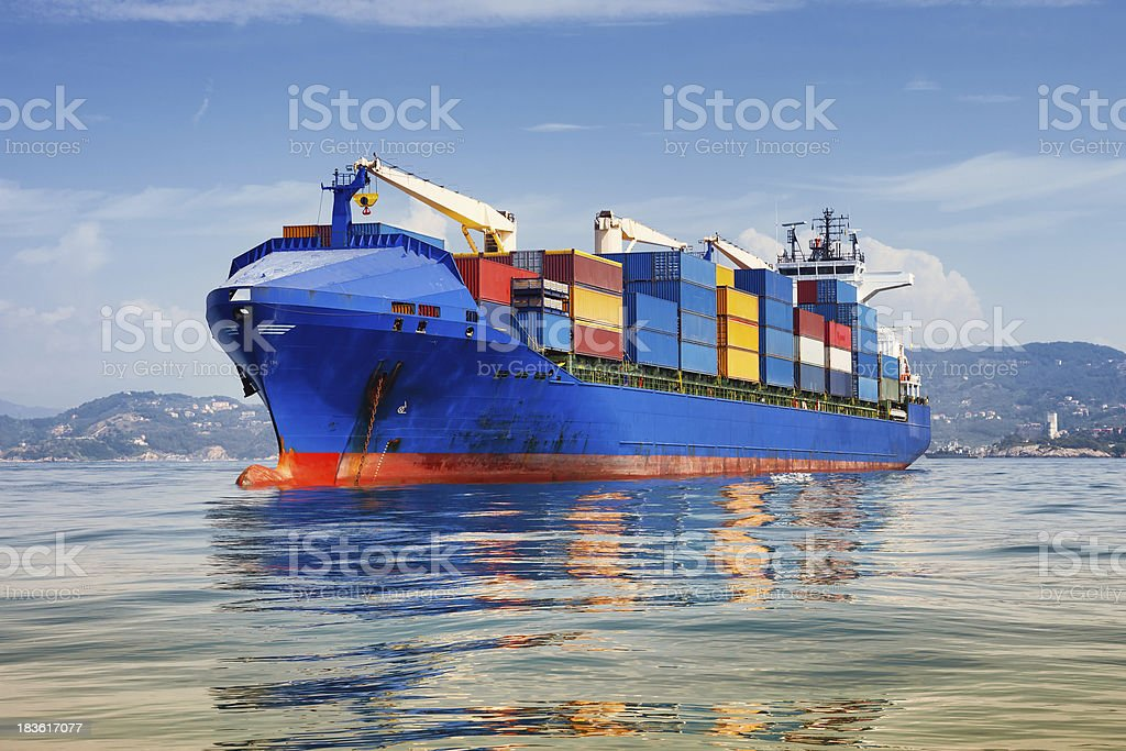 cargo ship full of containers stock photo