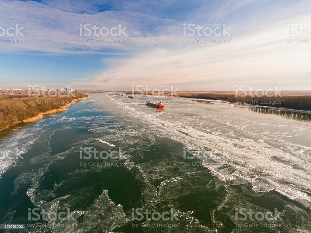 Cargo ship in beautiful frozen river. stock photo