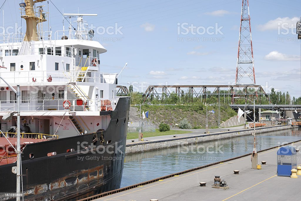 Cargo ship in canal lock. stock photo