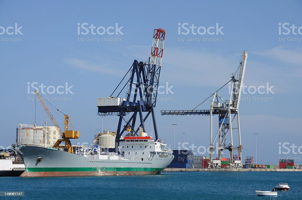 Cargo ship in port royalty-free stock photo