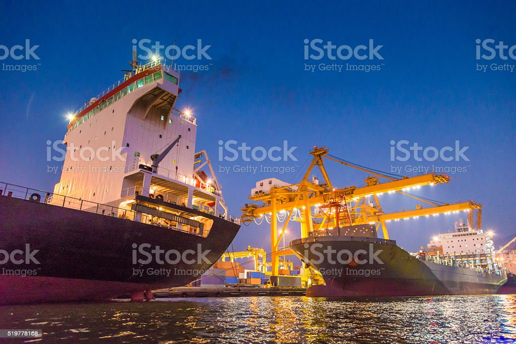 Cargo ship in the harbor at night stock photo