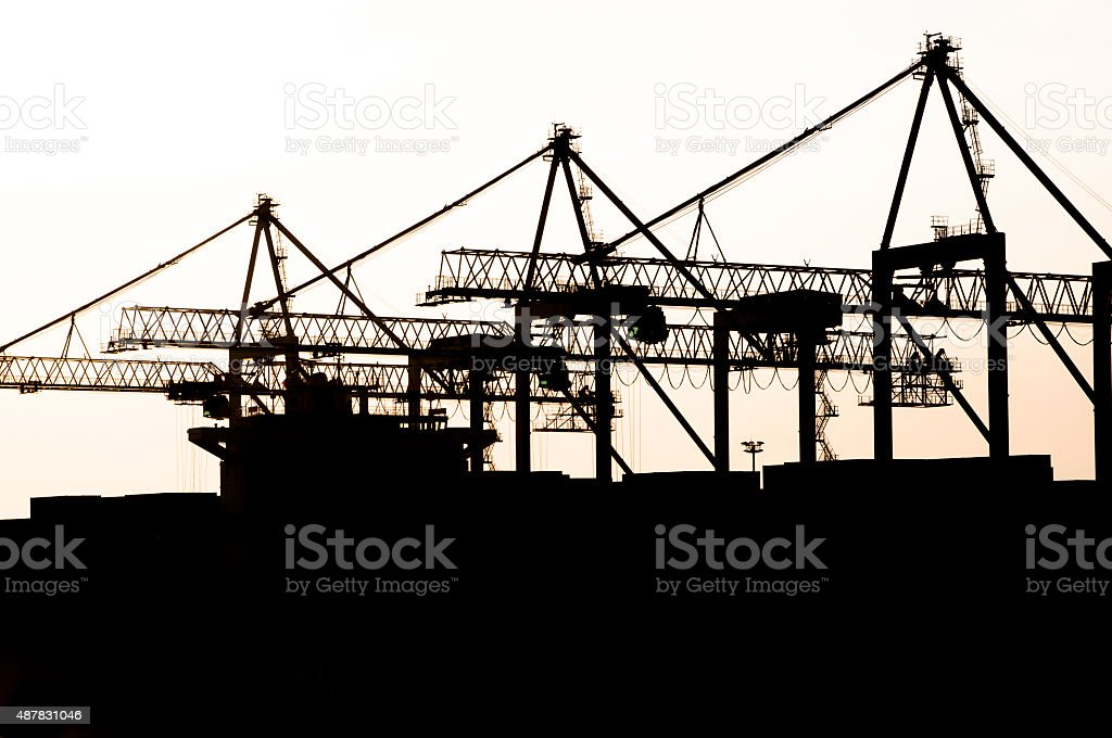 Cargo ship in the harbor, Commercial Dock at night stock photo