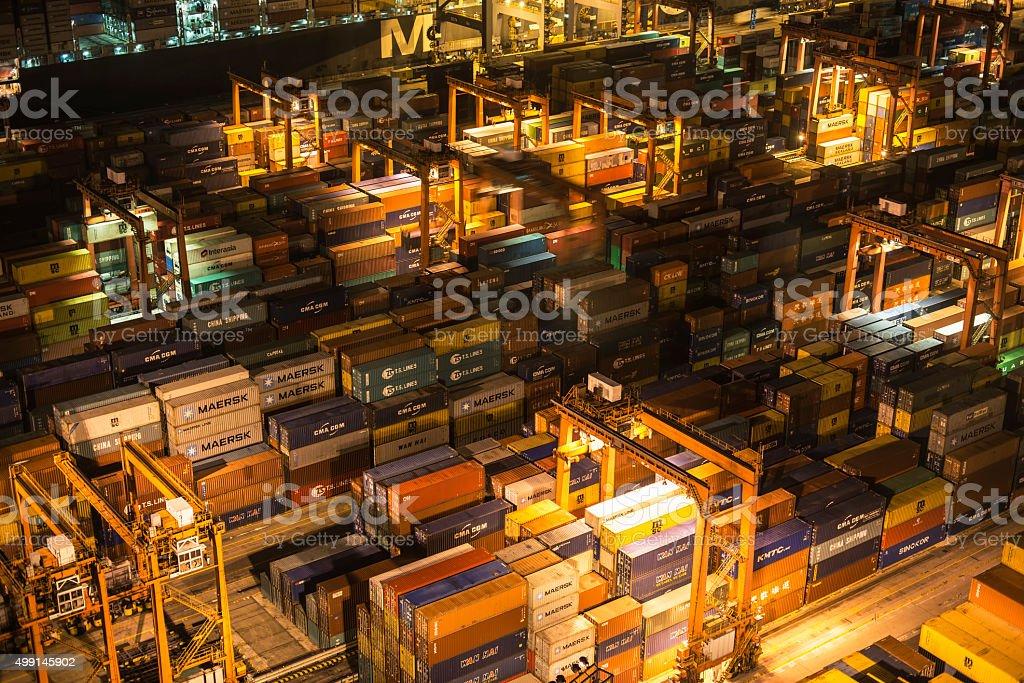 Cargo ship in the harbor in night stock photo
