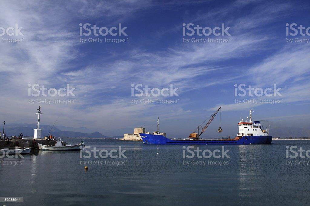 Cargo ship leaving harbor - Nauplio, Greece royalty-free stock photo