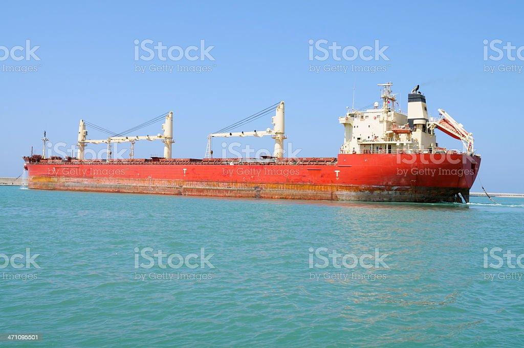 Cargo ship leaving the harbor royalty-free stock photo