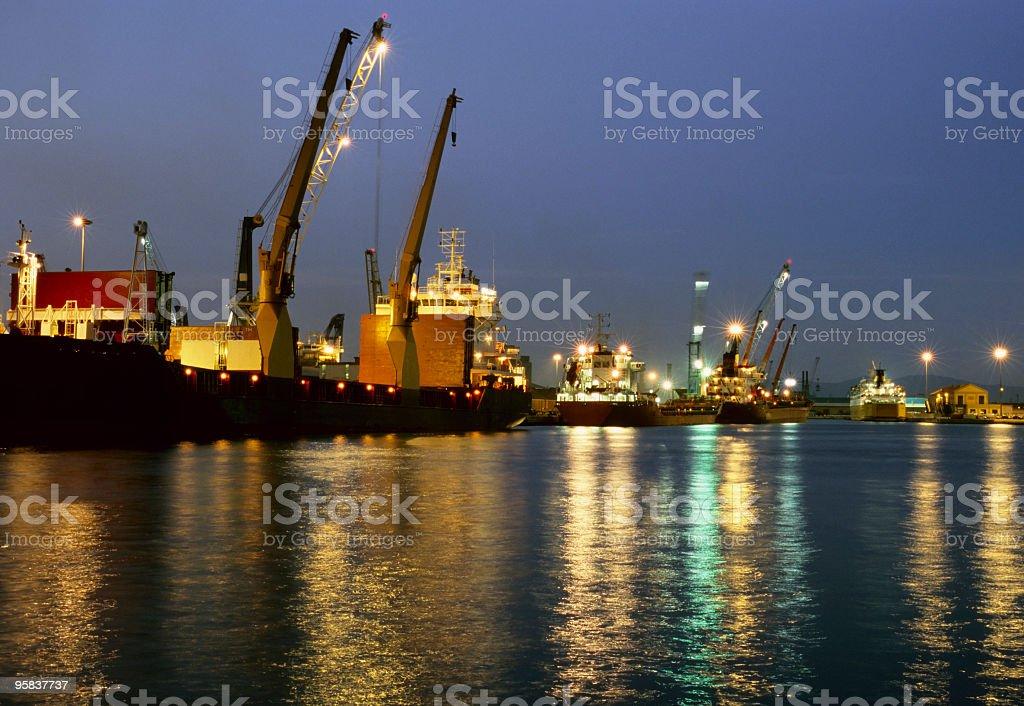 Cargo ship loading  at dusk. royalty-free stock photo
