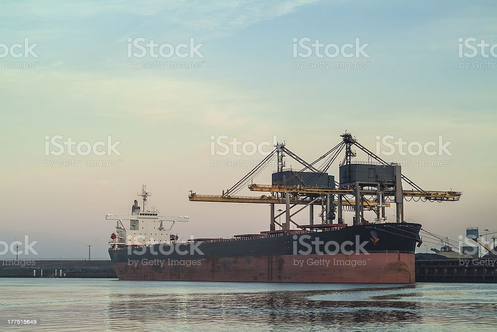 Cargo ship loading with coal in The Netherlands stock photo