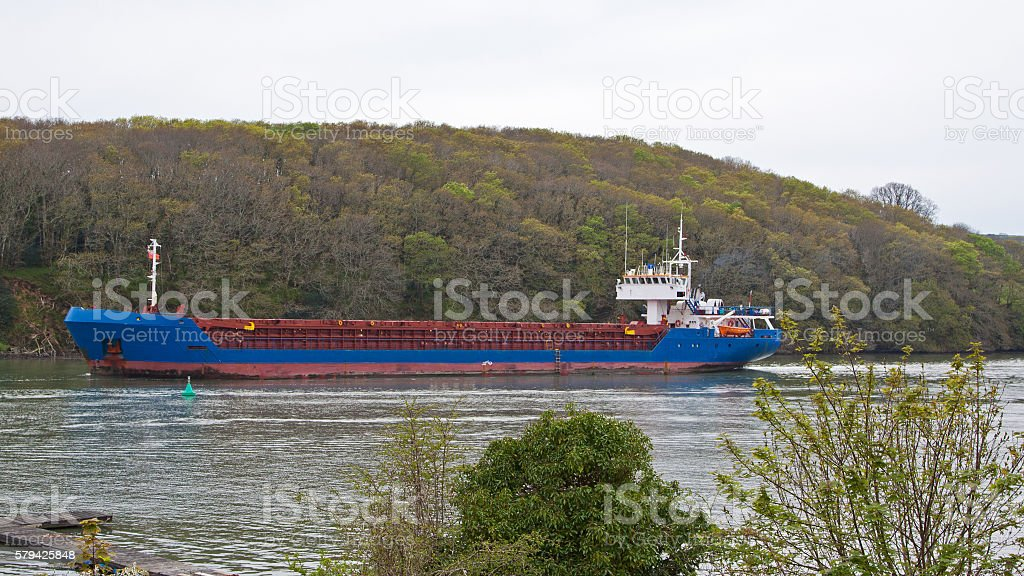 Cargo ship navigating the Truro river UK stock photo