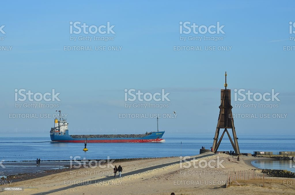 cargo ship next to Kugelbake in Cuxhaven stock photo