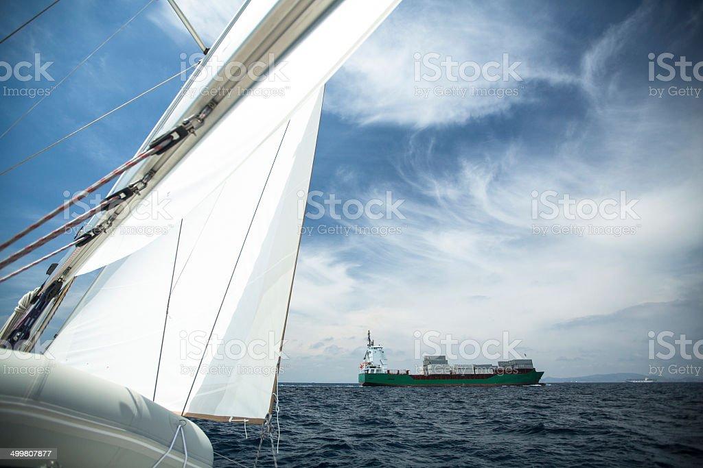 Cargo ship on the high seas stock photo