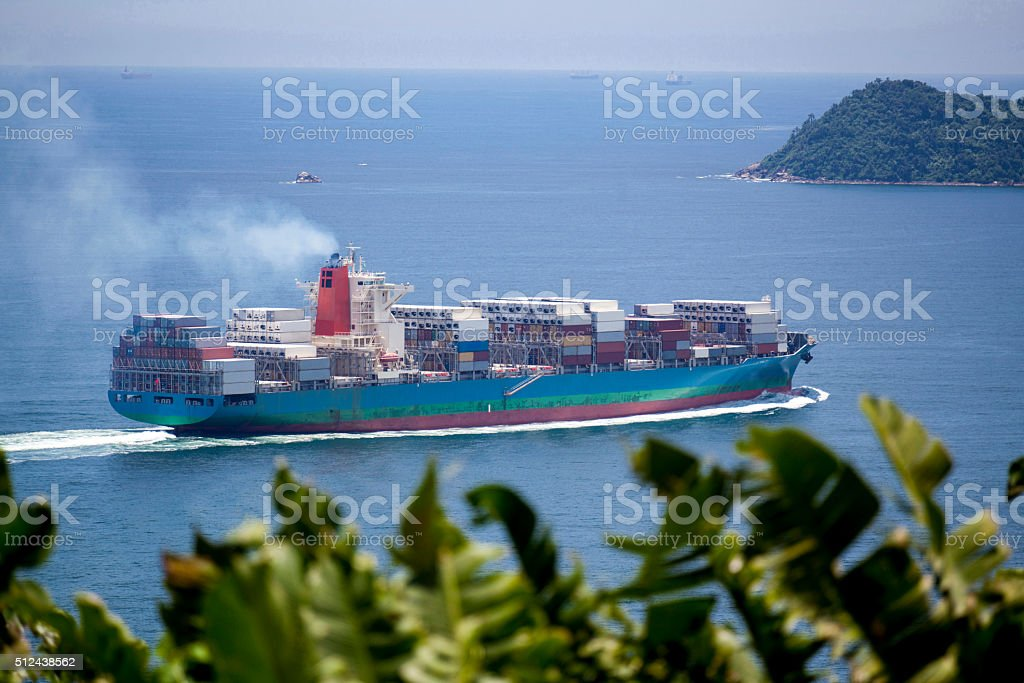 Cargo ship on the high seas stock photo