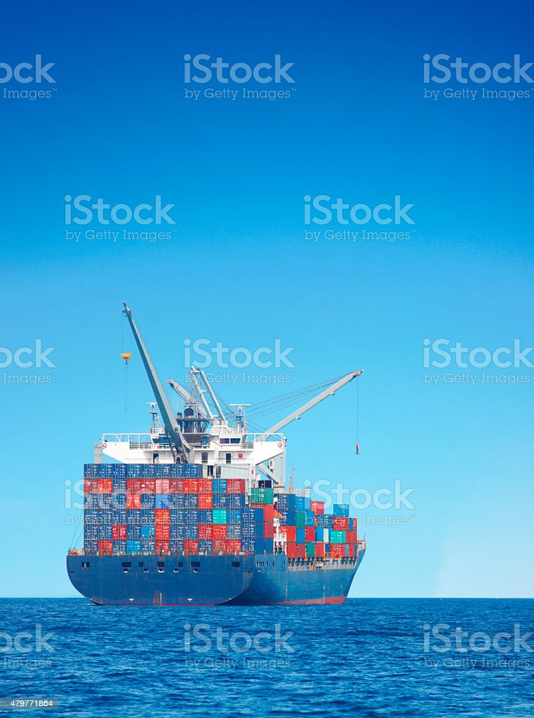 Cargo ship on the sea stock photo