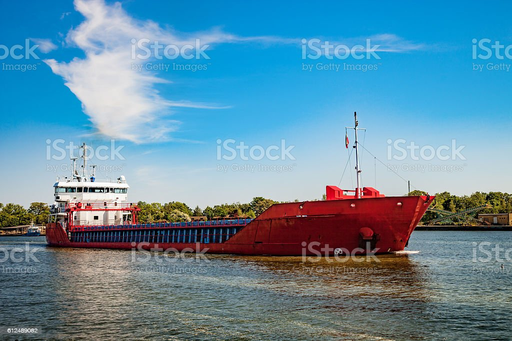 Cargo ship on the way stock photo