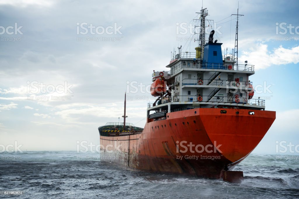 Cargo ship ran aground during storm stock photo