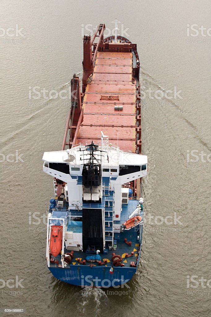 Cargo ship stern, Arial view, sailing under way stock photo