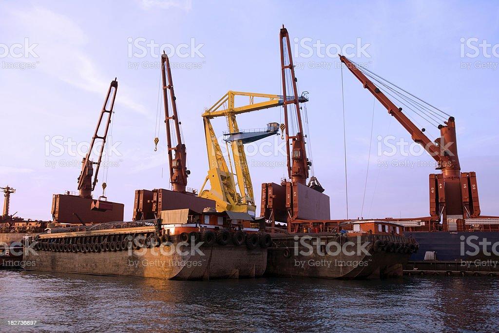 Cargo Ship Unloading Onto Barges royalty-free stock photo