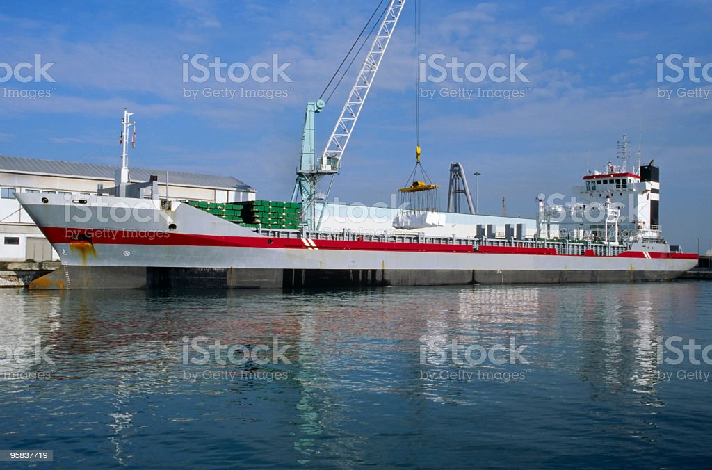 Cargo ship  unloading paper bales. royalty-free stock photo