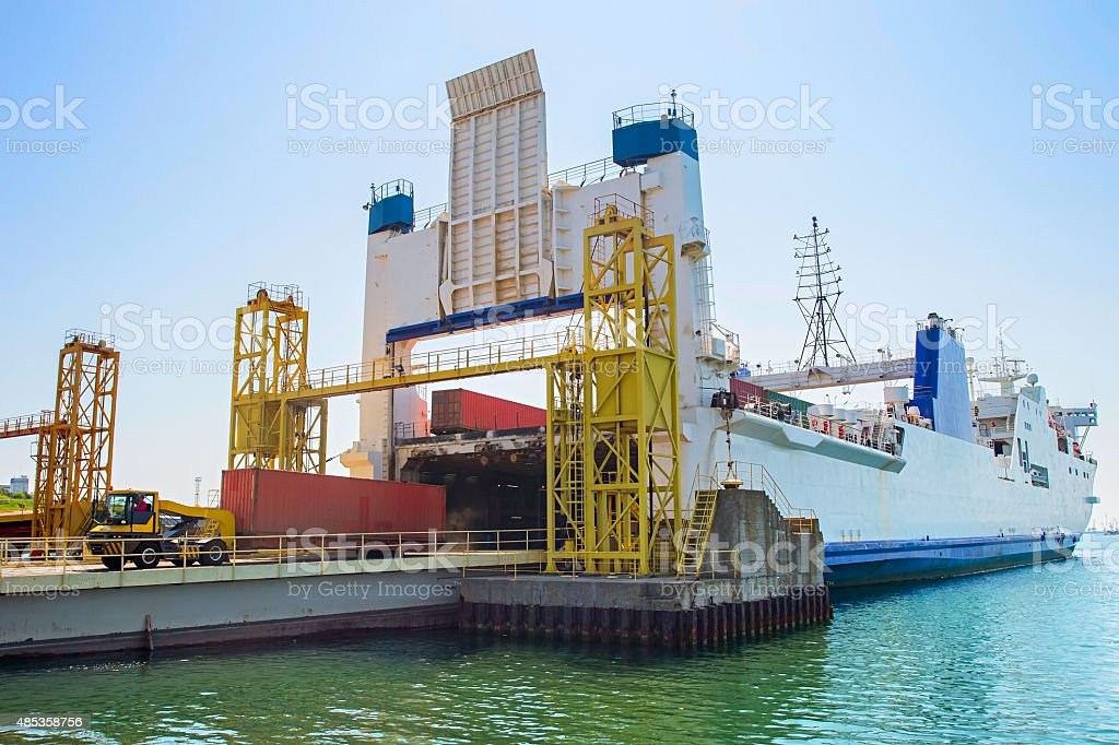 Cargo ship unloading stock photo