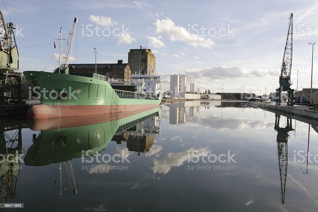 Cargo Ship Unloads at Rural Dockyard royalty-free stock photo