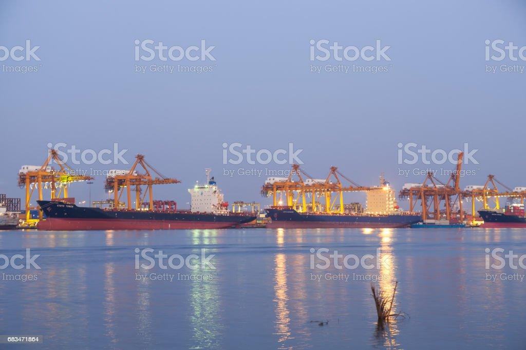Cargo ship while docking stock photo