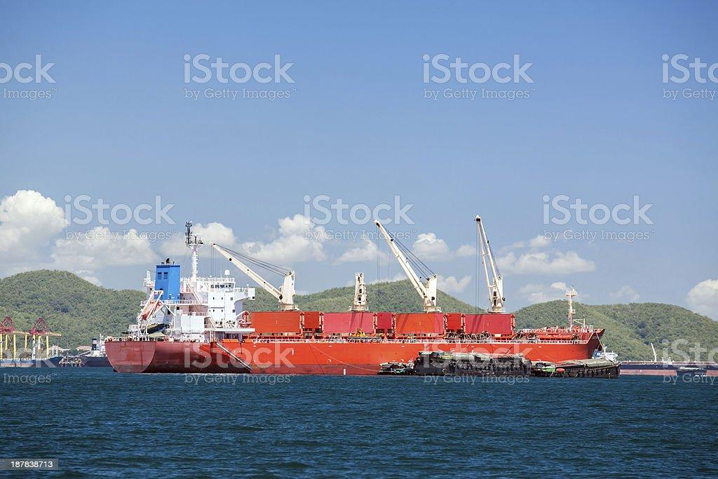 Cargo ship with cranes royalty-free stock photo