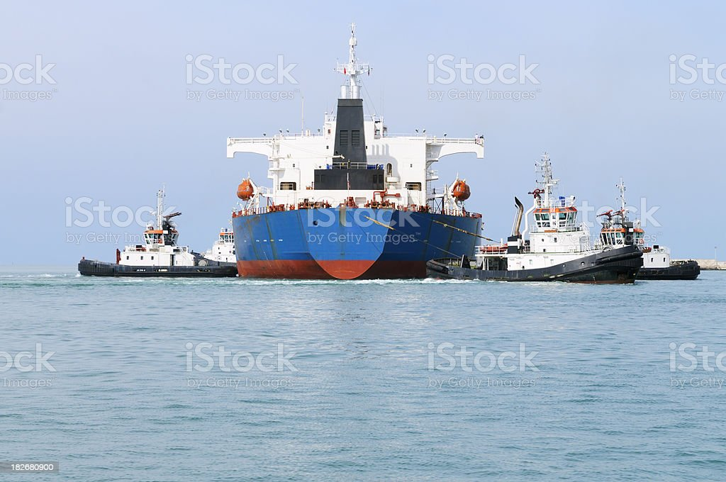 Cargo Ship with Tugboats royalty-free stock photo