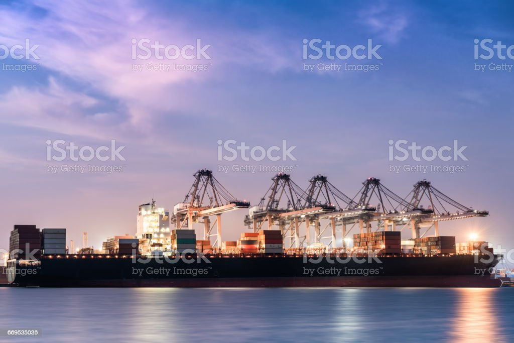 Cargo shipping and terminal unloading in twilight. stock photo