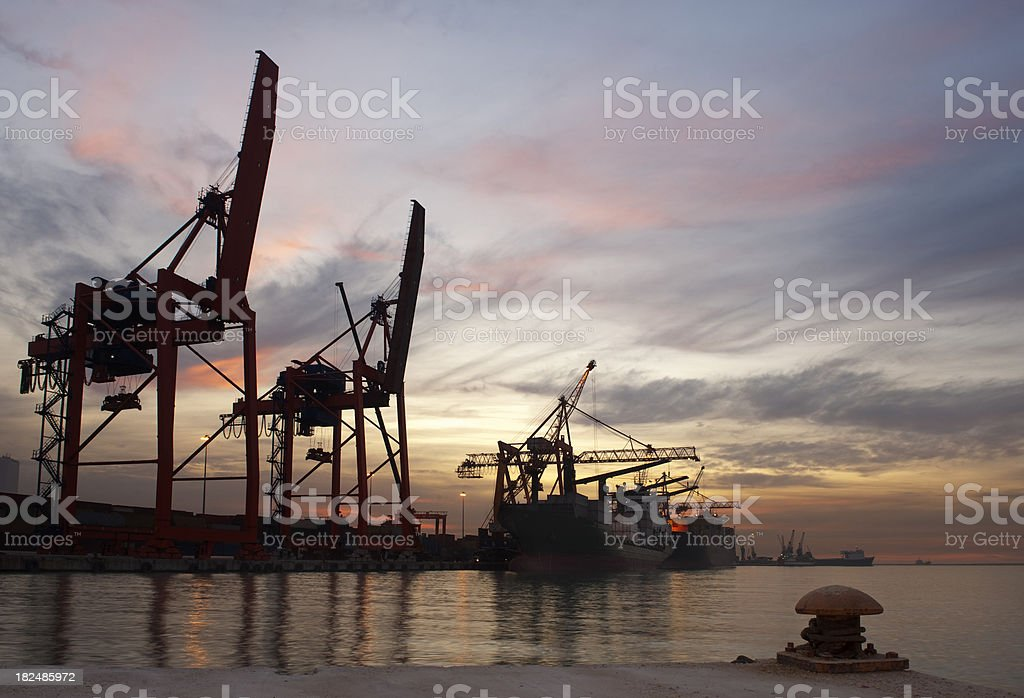 Cargo ships and port cranes royalty-free stock photo
