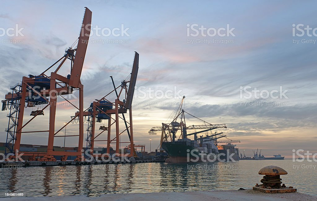Cargo ships and port cranes stock photo