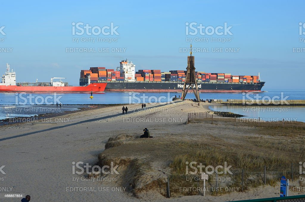 cargo ships next to the Kugelbake in Cuxhaven stock photo