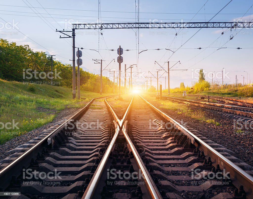 Cargo train platform at sunset. Railroad in Ukraine. Railway stock photo