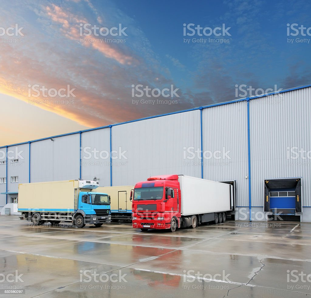 Cargo truck at warehouse building stock photo