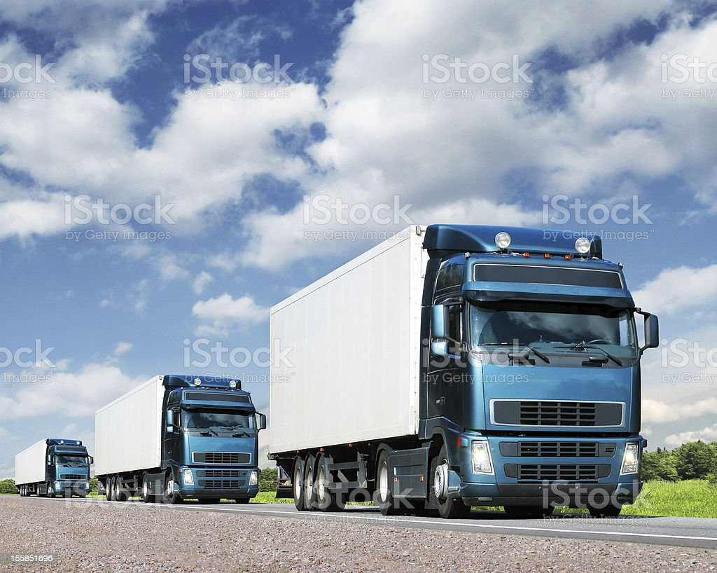 Cargo truck caravan on highway stock photo