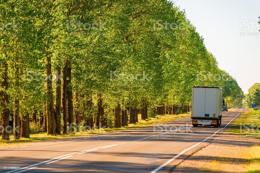 cargo truck driving on suburban highways in summer stock photo