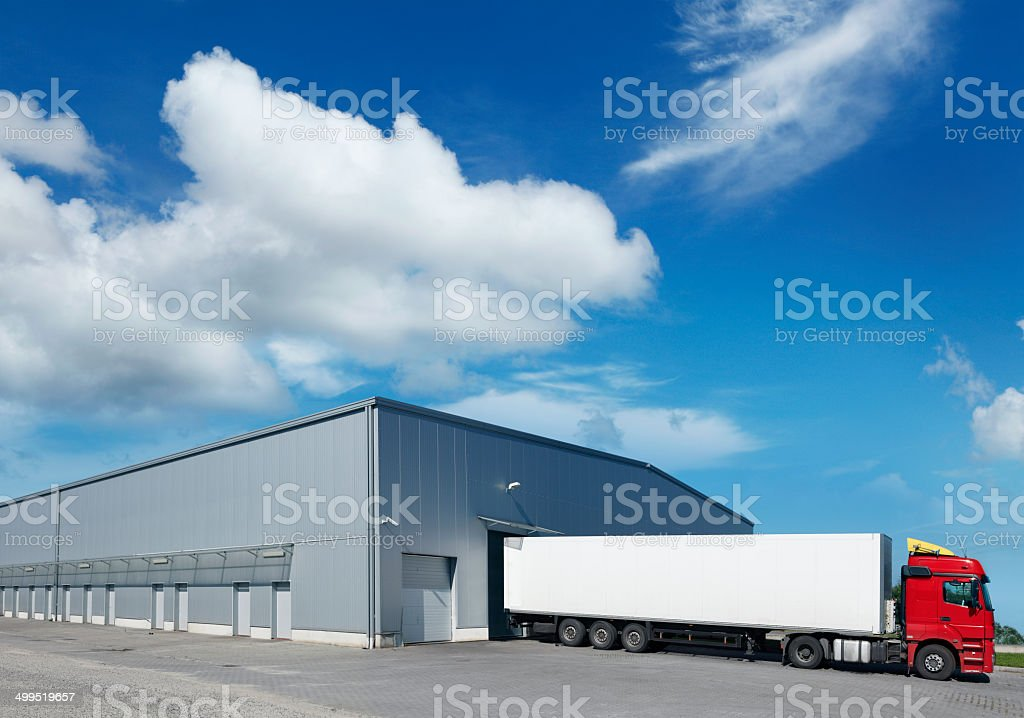 Cargo truck in warehouse stock photo