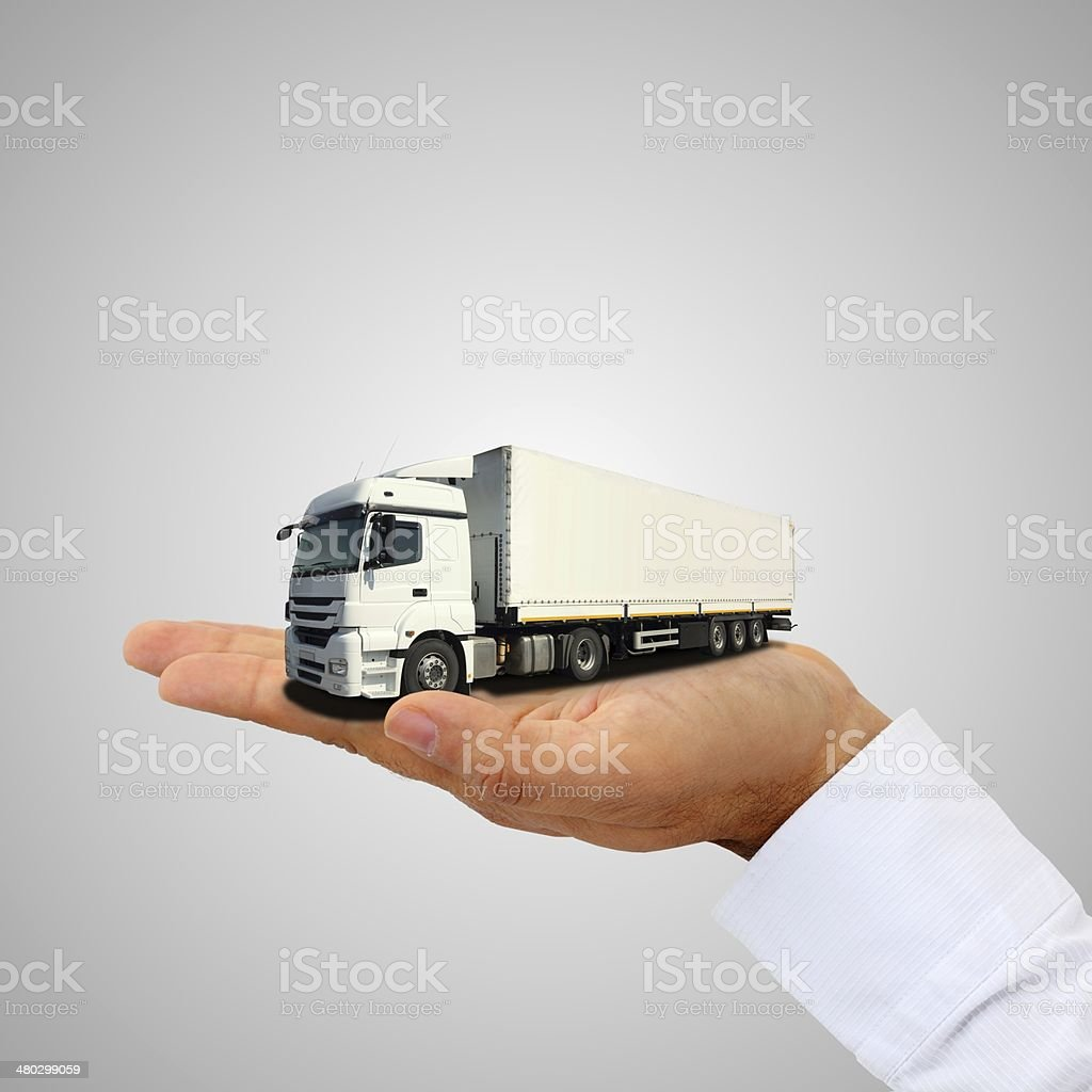 Cargo truck on the hand stock photo