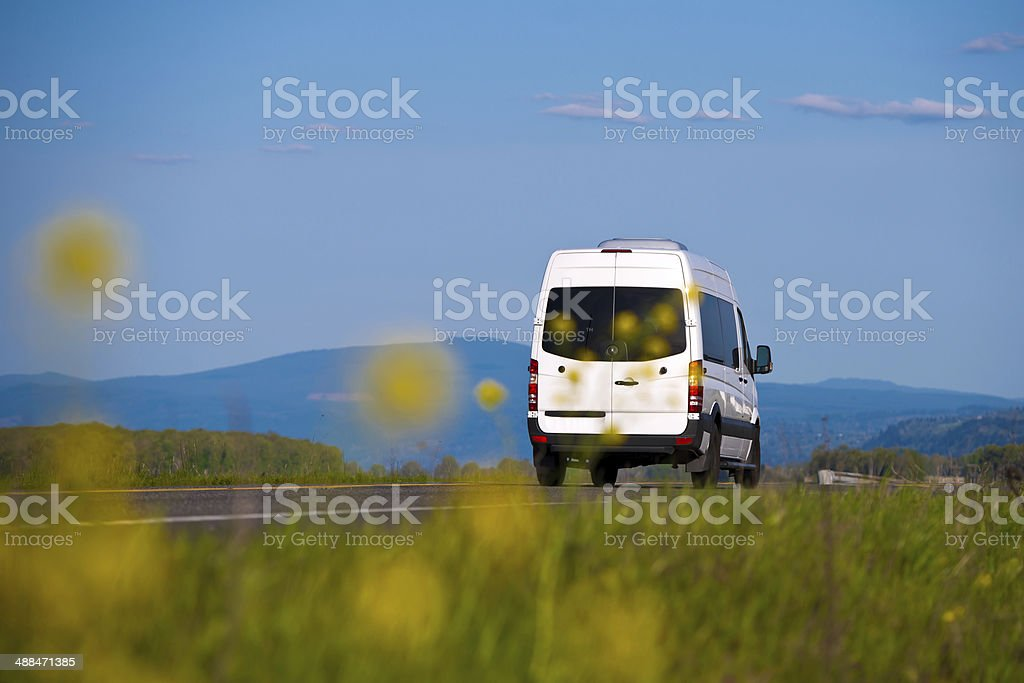 Cargo van inscribed in the natural landscape stock photo