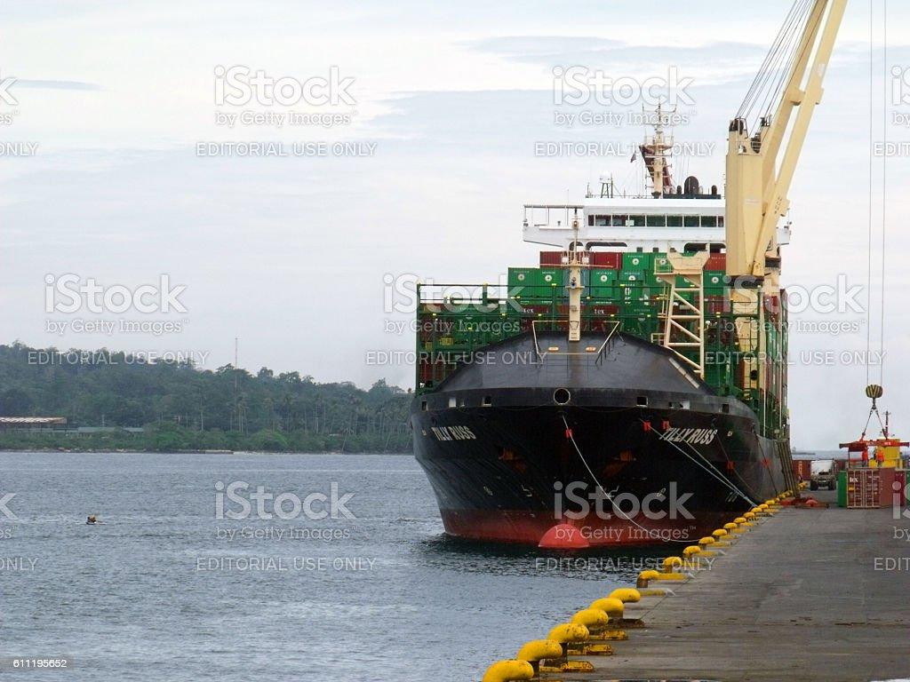 Cargo vessel loading container van stock photo