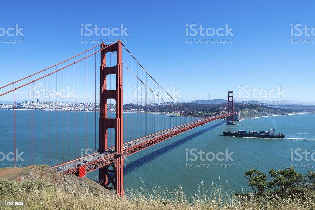 Cargo Vessel Under the Golden Gate Bridge royalty-free stock photo
