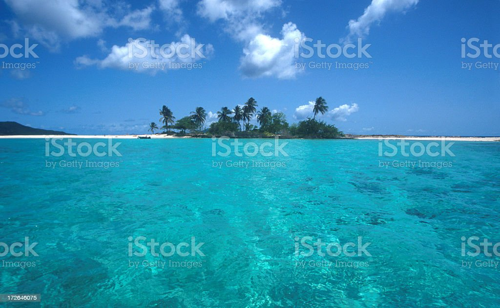 A Caribbean beach island and tropical clear waters stock photo
