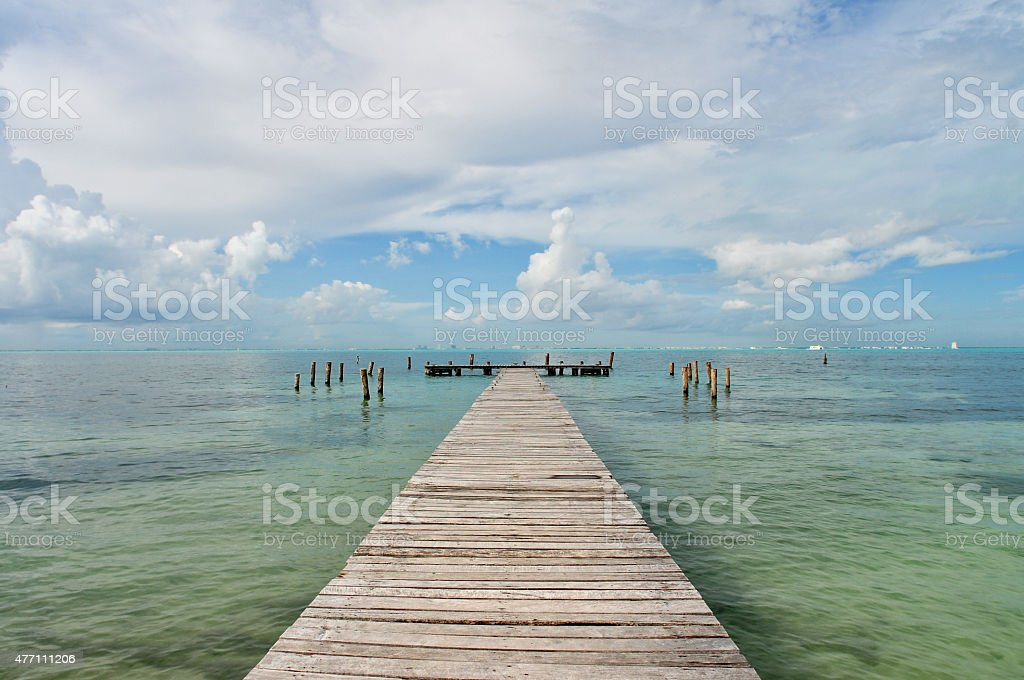 Caribbean Beach. Wooden Pier. Turquoise Water. stock photo