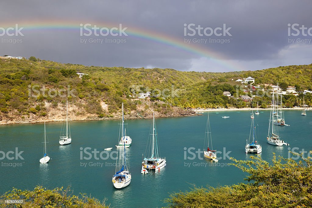 Caribbean Harbor With Sailboats And Rainbow stock photo