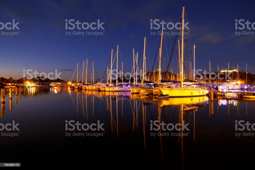 Caribbean Harbour With Sailboats At Night royalty-free stock photo